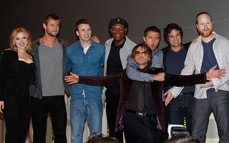 Cast members of The Avengers appear on stage with director Joss Whedon during a panel at Comic-Con